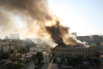 Fire burns at Shoura Council near Egyptian Parliament in Cairo