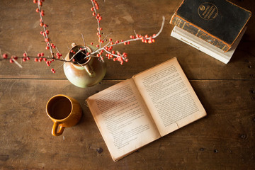 book and coffee on vintage table