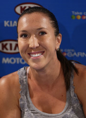 Jelena Jankovic of Serbia listens to questions during a news conference in Melbourne