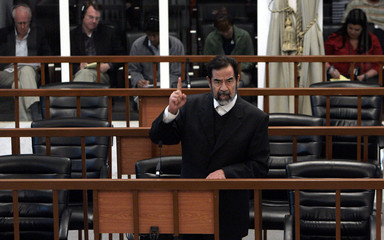 Former Iraqi president Hussein argues during his trial in Baghdad