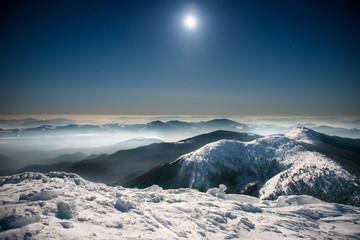 Foto op Plexiglas Zwart Range of winter mountains at night
