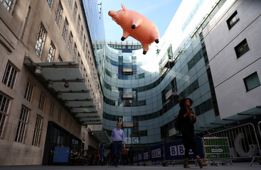 The Pink Floyd inflatable pig floats next to Broadcasting House to promote their new exhibition at the V&A museum, in London