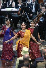 Indian dancers perform in front of Queen Elizabeth and Prince Philip during Commonwealth Day Service at St Andrew's Cathedral in Sydney