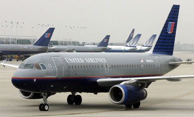 A United Airlines airplane pulls into the United Terminal at O'Hare International airport in Chicago