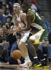 Bobcats forward Herrmann plays close to Supersonics center Petro in Charlotte