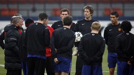 Manchester United coach Alex Ferguson talks during the training session in Milan