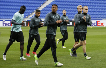 Ajax's Kenny Tete and teammates during training