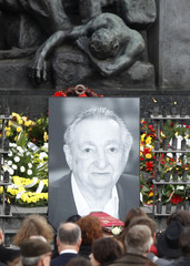 A picture of Marek Edelman is placed at the Monument of the Ghetto Uprising in Warsaw