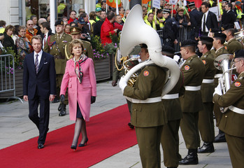 Luxembourg's Grand Duke Henri and Ireland's President McAleese review troops during a welcoming ceremony in Luxembourg