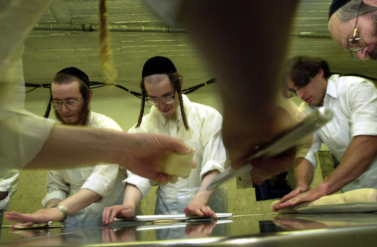 ULTRA ORTHODOX JEWS MAKING MATZAH BY HAND IN ADVANCE OF PASSOVER IN JERUSALEM.