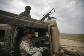 U.S. soldiers sit in a Humvee during a media briefing in Babadag