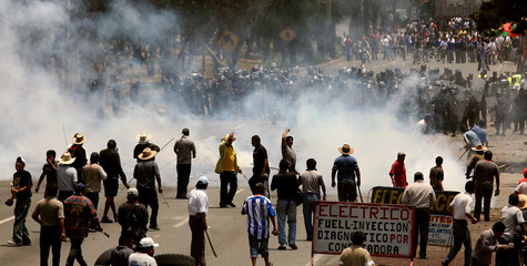 Villagers clash with police in the village of San Salvador Atenco