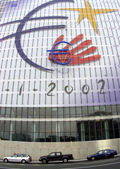 A 2000 square meters flag depicting the symbol of the euro hangs from a European Union building in B..
