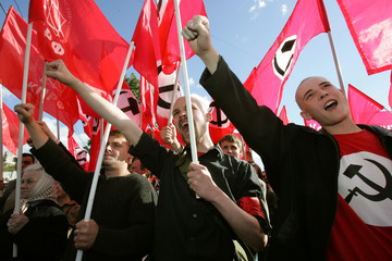Communist demonstrators shout slogans at an anti-government rally in central Moscow.
