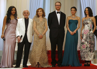 French singer Aznavour, actress Herzi and jury members pose during the opening ceremony of the 62nd Cannes Film Festival