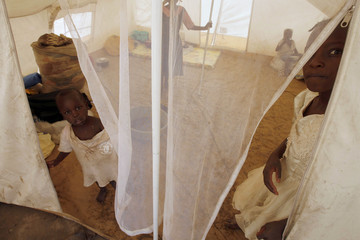 Children displaced during post-election violence stand in their tent on the outskirts of Naivasha