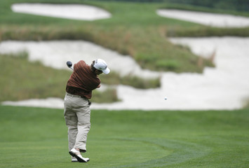 Amateur Ben Martin of the U.S. hits his approach shot to the fourth hole during completion of the rain-delayed first round in the U.S. Open golf championship