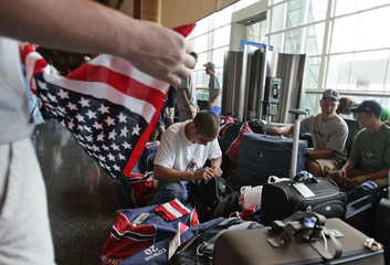 Man repacks his bags before going through a security checkpoint at Logan International Airport in Boston