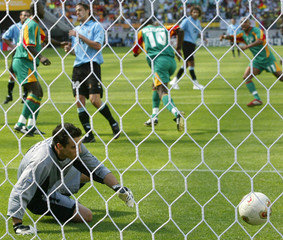 URUGUAY'S GOALKEEPER CARINI WATCHES AS SENEGAL PENALTY GOES INTO THENET DURING THEIR WORLD CUP ...