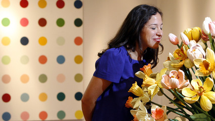 Contemporary Art specialist Pilar Ordovas views 'A Small Vase of Flowers by artist Jeff Koons at Christie's auction house in central London