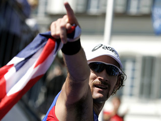 Winner Don of Great Britain celebrates after winning the men's Elite competition at the ITU Triathlon World Championships in Lausanne
