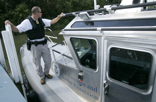 US Department of Homeland Security Customs and Border Protection Air and Marine Operations Agent Scott Leach stands on the back of a border patrol boat while its docked at  Lake Erie in Gibralter, Michigan