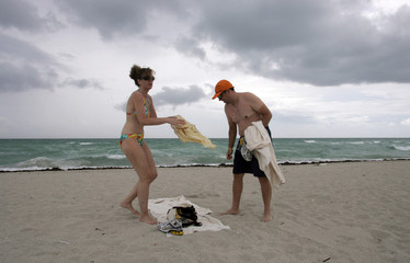 Rich and Sandy Tullo of New York City pack their belongings after being told to leave Miami Beach