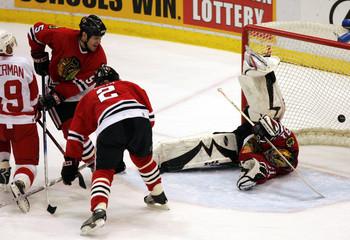 Detroit Red Wings Yzerman scores a goal against Chicago Blackhawks goalie Anderson in Detroit