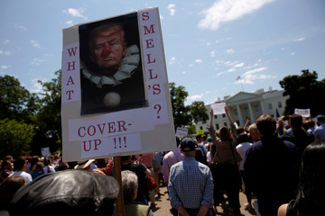 Protesters gather to rally against Trump's firing of Comey, outside the White House in Washington