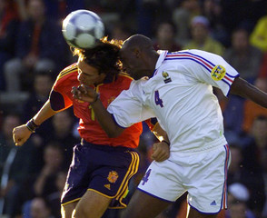 SPAIN'S ALFONSO JUMPS FOR A HEADER WITH PATRICK VIEIRA OF FRANCE DURING THEIR EUROPEAN ...