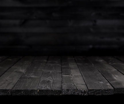 Dark wooden table for product, old black wooden perspective interior