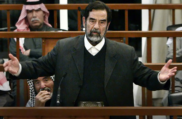 Former Iraqi President Saddam Hussein speaks at his trial in Baghdad