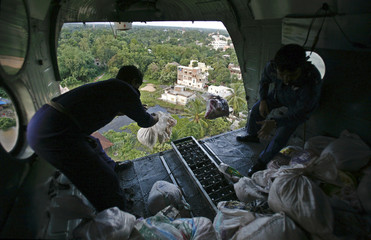 Indian Air Force personnel drop food packets from a helicopter in Midnapore
