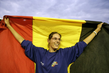 Hellebaut of Belgium celebrates with national flag after winning high jump final at European athletics championships in Gothenburg