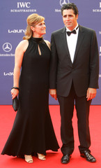 Spain's cycling legend Indurain and his wife arrive at Laureus World Awards ceremony in Barcelona