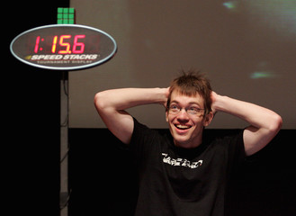 Chris Krueger of Denver, Colorado, celebrates after solving a Rubik's cube puzzle in 1 minute 15 seconds