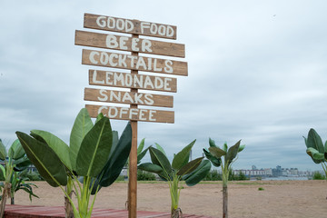 Cafe signpost on the beach