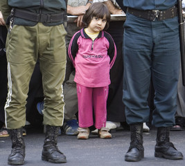 A girl attends the hanging of Majid Kavousifar and Hossein Kavousifar in Tehran