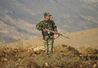 A Turkish soldier patrols the south-eastern Turkish province of Sirnak