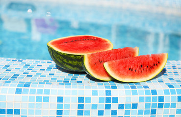 Watermelon slices near the pool