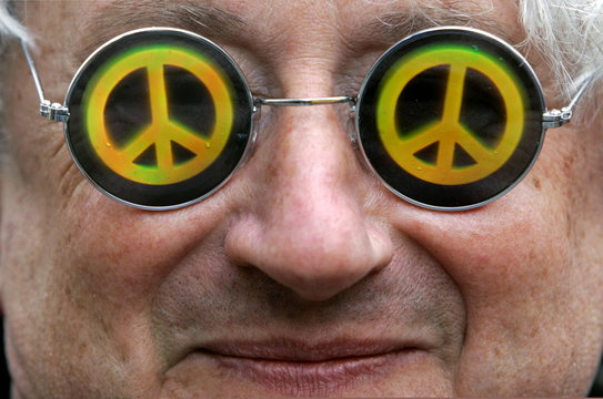 A protestor wears sunglasses with a peace sign during a demonstration in Munich February 12, 2005. S..