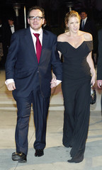 ELVIS COSTELLO AND DIANA KRALL LEAVE THE VANITY FAIR OSCAR PARTY.