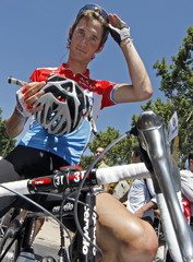 Team CSC Saxo Bank rider Franck Schleck of Luxembourg adjusts his sunglasses at the start of the thirteenth stage of the 95th Tour de France cycling race between Narbonne and Nimes