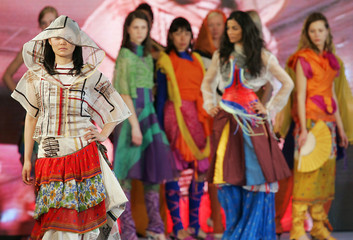 Models display creations designed by students during a dress rehearsal for the fashion show 'WeltGewaender'  in Berlin