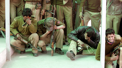 Indian policemen cry during funeral of four slain colleagues in Srinagar
