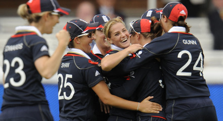 England's Brunt is congratulated after taking the wicket of New Zealand's Doolan during the ICC World Twenty20 women's cricket final at Lord's cricket ground in London