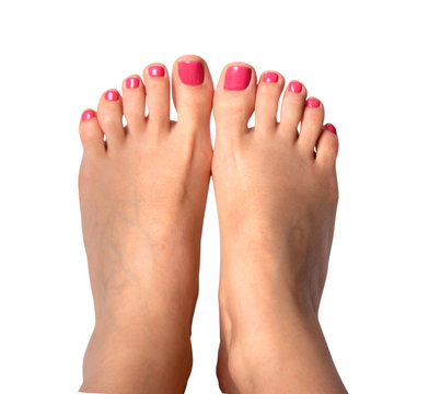 Beautiful feet with perfect spa nail pedicure on white background