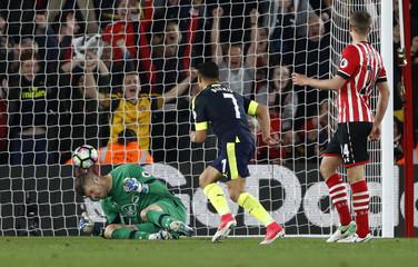 Arsenal's Alexis Sanchez scores their first goal