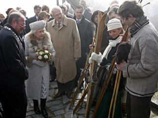 Britain's Queen Elizabeth, accompanied by Slovak President Ivan Gasparovic, speaks to young sportsmen at the High Tatras resort Hrebienok
