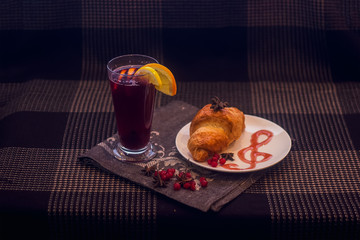 juice and croissant on a plate